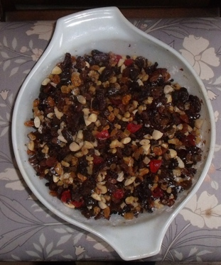 bowl of dried fruit and nuts for making a heavy fruit cake